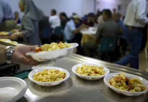 """Free meals are served in a """"soup kitchen"""" run by the Sant'Egidio Christian community in Rome September 17, 2008. The euro zone's third largest economy, Italy has been one of its most sluggish performers for more than a decade, and has suffered more than most of its partners from surging oil prices, a strong currency and the international slowdown. Statistics show that Italy is growing older and poorer while the economy underperforms its European peers.    To match feature FINANCIAL-ITALY/POOR     REUTERS/Tony Gentile        (ITALY)"""