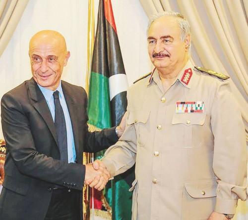 Una foto tratta dal profilo Facebook del 'Media office of lybian army' mostra Il ministro dell'Interno, Marco Minniti, con il generale Khalifa Haftar durante il loro incontro a Bengasi, 5 Settembre 2017.    +++ATTENZIONE LA FOTO NON PUO' ESSERE PUBBLICATA O RIPRODOTTA SENZA L'AUTORIZZAZIONE DELLA FONTE DI ORIGINE CUI SI RINVIA+++